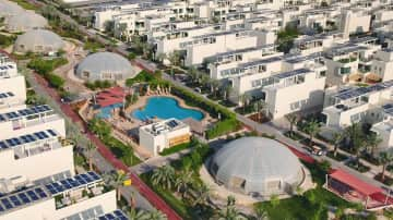 The Sustainable City Dubai. Green oasis in the desert. Buggy sharing system to get around inside the compound. Parking space 20 seconds walk from the villa.