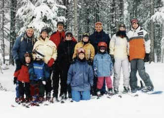 Love family and love to ski...this is an old picture, but one of my favorites.  We all wear helmets nowadays!!