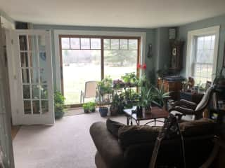 Sunroom over looking field and lake