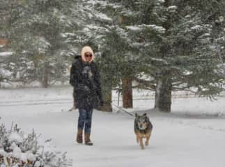 Neilia walking Nora in the snow. This rescue dog loves snow!