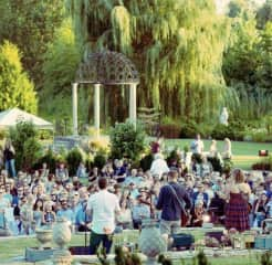 I produce and present live concerts for a living. This was a special one. Canadian singer-songwriter Sarah Harmer live, outdoors in a beautiful garden. It was a perfect day.