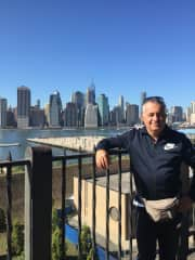 Ray with the Manhattan skyline in the background