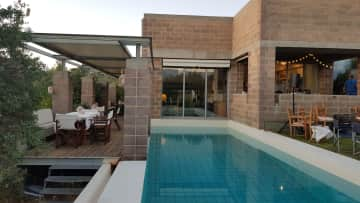 Pool with view to front room and kitchen