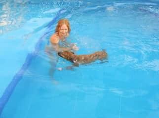 Teaching Dahlia how to swim.