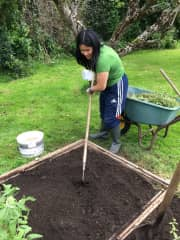 Úna-Minh working hard in our garden at home in Kerry,