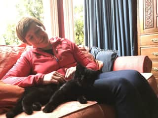 Mel and Nutkin in Chorlton - never happier then when curled up with a cat!