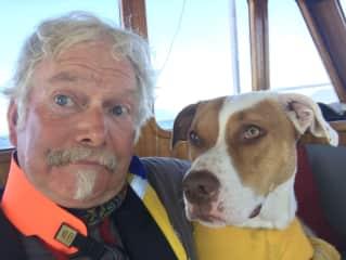 Jim and Issi, dog sitting on board in British Columbia.