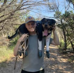 My son carrying Finn when he decided he was done after an 6 mile hike