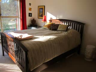 Large bright bedroom with queen sized bed