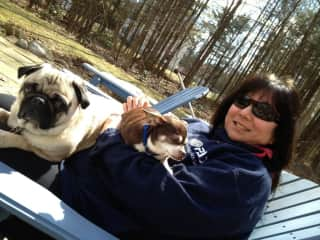 Maria with Vermeer the pug and Tito the  Chihuahua