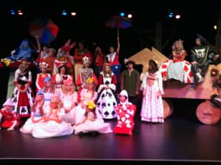 I write plays and musicals and teach children's theatre. Pic is cast of Alice in Wonderland.