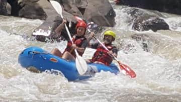 Nick and Marina river rafting down the Zambezi river