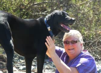 Laurie and Bailey, black lab mix