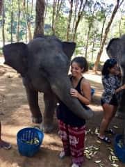 Carmen getting a hug from her favorite animal in Phuket, Thailand