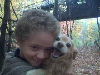 Nolan with our last dog Mitsy!  We miss her!