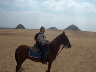 Me on Maggie, a half Arabian. She flew over the dunes near Saqqara, Egypt.