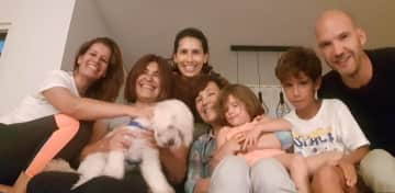 Nieces and family - and Patti, the white poodle and bundle of joy