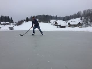 Playing ice hockey in what is usually the meadow