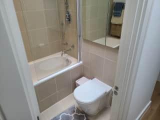 Upstairs hallway bathroom w/ bathtub & shower