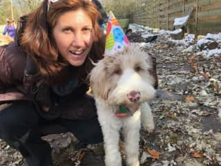 Marina with Hazel, a service dog we're raising
