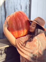 This is me, hugging a giant pumpkin in Sedona, AZ