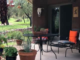 Back patio has great views of the bird feeders and bird bath.