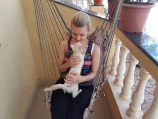 Jo cuddling a stray cat in Goa, India