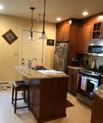 Gas stove, dishwasher, and also in unit laundry (washer and dryer).
