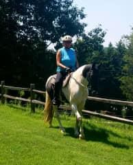 Elizabeth riding one of the horses