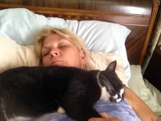 Linn and favorite cat Squeaker napping