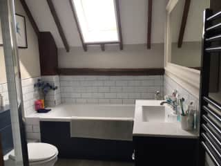 Newly renovated main bathroom with bath & shower.