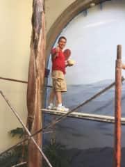 David painting a mural
