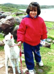 My love for animals developed at a young age :) Picture taken near Cuzco, Peru.