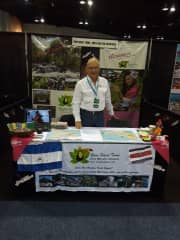 Arturo at the Denver Travel and Adventure Show representing our company Rain Forest Tours