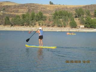 Debbie on the paddle board