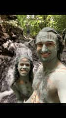 Amanda and I covered in clay in the jungle for the summer solstice.