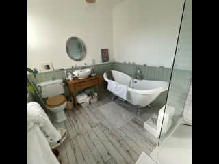 Bathroom with lovely bath And separate walk in shower