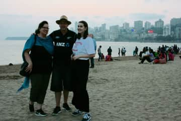 We love to travel and we have lived in many interesting places.  Here we are with or daughter, Olivia at Chowpatty Beach in Mumbai, India
