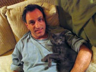 Babak hanging out with our cat, Luna.