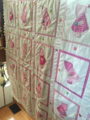 This is a Sunbonnet Sue queen size quilt I just finished for a client. I love to quilt.