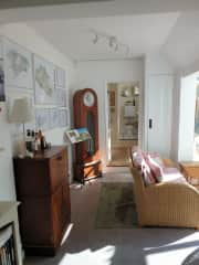 Study area leading to conservatory, downstairs toilet and shower, and stable door to rear garden.