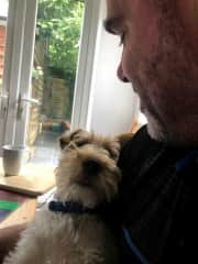 Ted 'helping' Clark with work on the computer in England