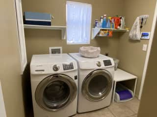Washer and dryer next to our cat's PetSafe® ScoopFree® Self-Cleaning Litter Box.