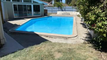We're currently having our landscape redone so the cement around the pool has been removed. The pool is not heated but typically around 78 degrees right now.