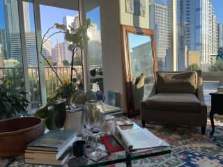 View of Uptown from my favorite chair in the living room at sunset near the solstice.