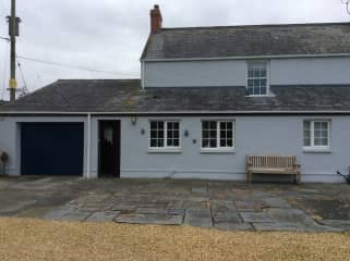 rear entrance and garage with electric opener