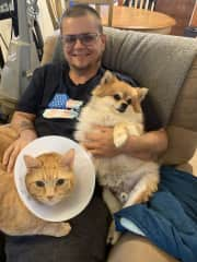 Here's Dylan with two of our beloved pets! One of our kitties (Floyd) had a minor surgical procedure and had to rock a cone for a bit.
