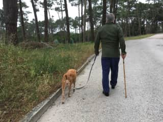 Youn walking Lucy in Portugal