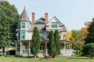 1895 Victorian with wrap around porch and nearly an acre of land!