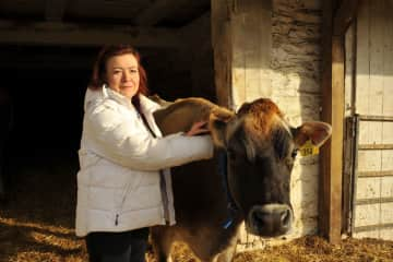 Jane with her cow, Trueheart